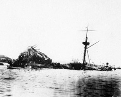 The battered remains of the USS Maine following a mysterious explosion.
