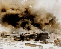 The African-American district burns during the Tulsa race riots of May, 1921.