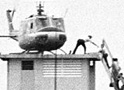 Vietnames refugees climb into a helicopter